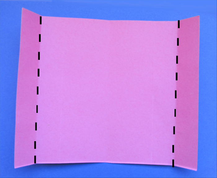 Fold the left and right edges to the crease marks you just made in the last step. 