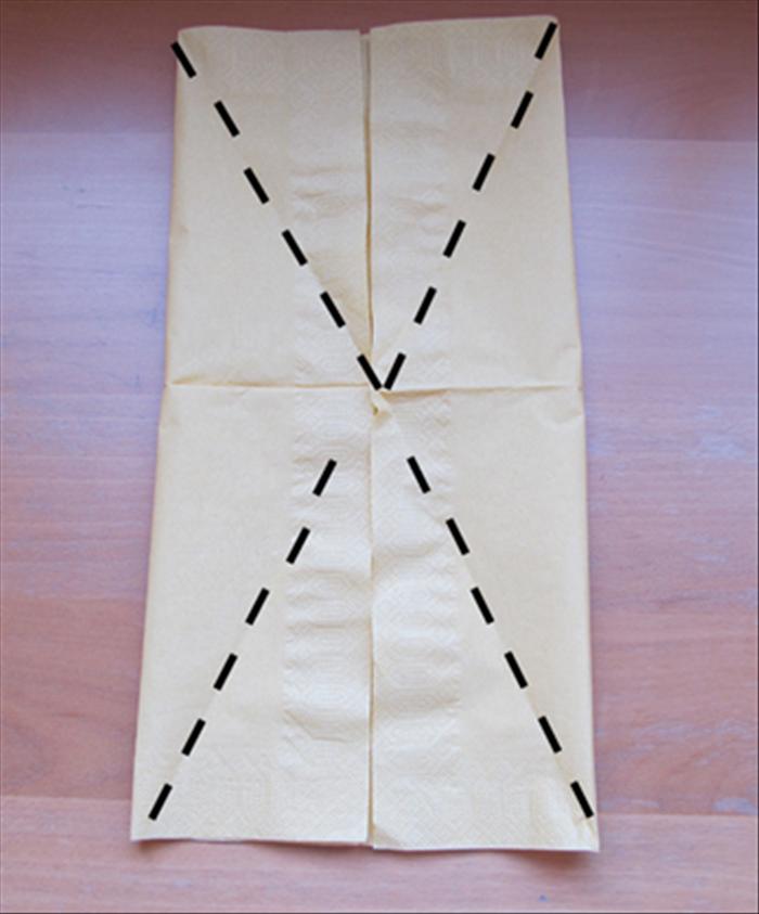 Take each of the four open corners of the flaps you just made and fold them out diagonally, pivoting at the center.