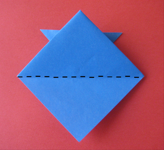 Flip the paper over to the back side and fold the bottom up at the center