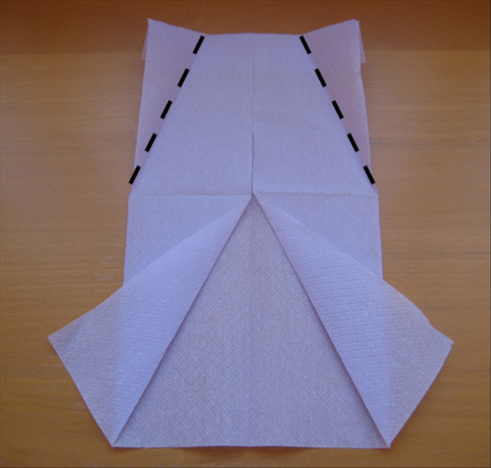 Flip the napkin over again.
