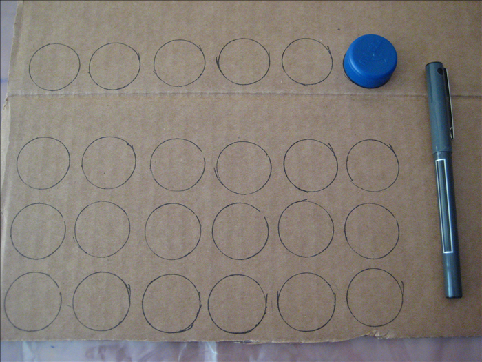 Trace 24 circles with the bottle cap.