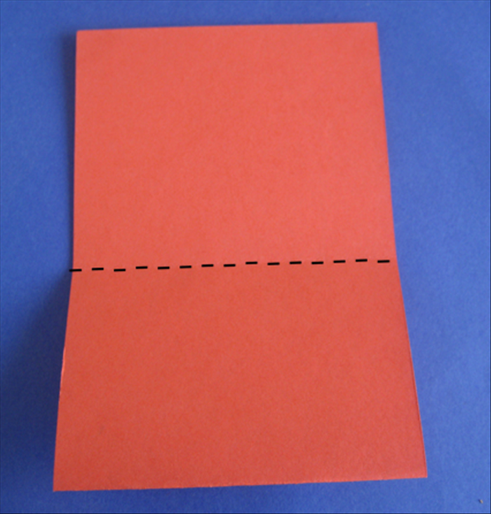 Turn the paper so that the open part is at the top  Fold down the top layer at the crease. Press down on the crease to make it sharp- then unfold  Flip the paper to the other side and repeat