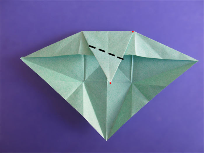 <p> Don't unfold the last side.</p>  <p> Rotate the paper.</p>   <p> Fold the tip to the top right point of the triangle. Make sure the sides are aligned.</p>   <p>  </p>