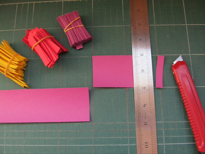 <p> Cut strips of paper 3 inches wide and then cut them into 3 / 4 inch strips.</p>  <p>  </p>
