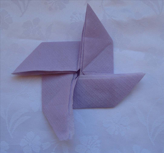Your napkin is folded into a pinwheel and ready to decorate your table!