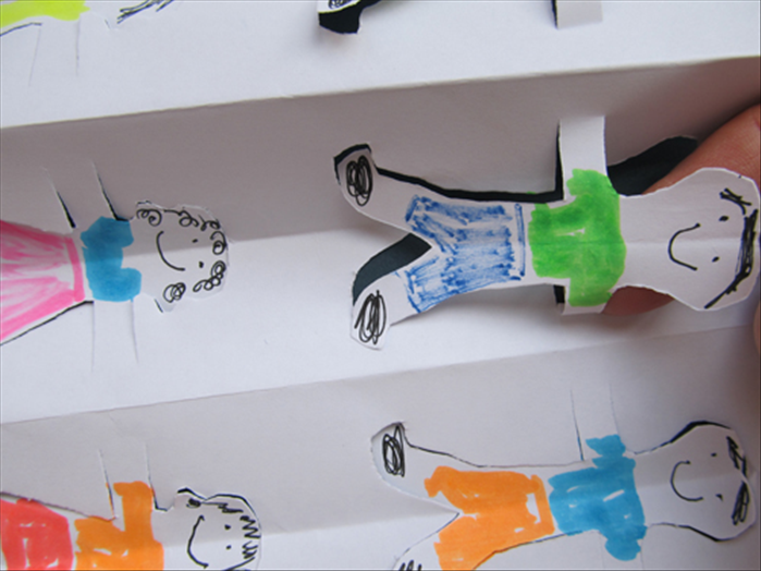 Stick your finger under each figure and press the ends of the arm to fold them against the paper