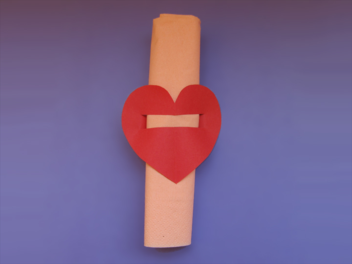 Slide the heart to the middle of the napkin roll. That's it!