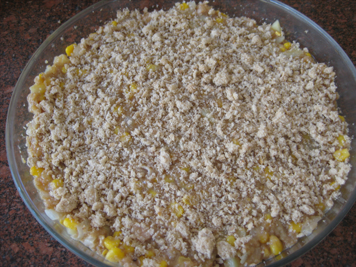 <p> Put the mixture into a greased baking dish and flatten with the back of a spoon</p>  <p> *optional – pour a tablespoon of oil over the top and spread it around with the back of a spoon</p>  <p> Sprinkle breadcrumbs over the top and press them down lightly</p>
