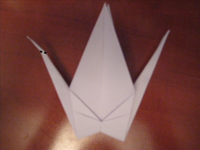 On one side only, make a fold at an angle. Crease it  sharply and unfold