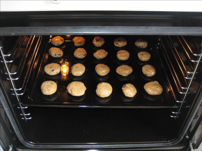 Wet your hands a little to prevent the dough from sticking to them and make balls from a tablespoon of dough.