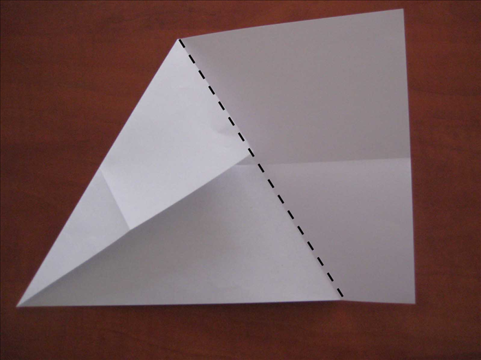 Fold the right side of the paper over the edge of the fold you just made.