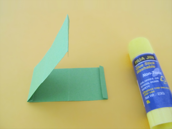 <p> Fold the paper along the glued edge.</p>  <p> Glue the other 2 end folds together.</p>  <p> Make sure they are aligned.</p>  <p>  </p>