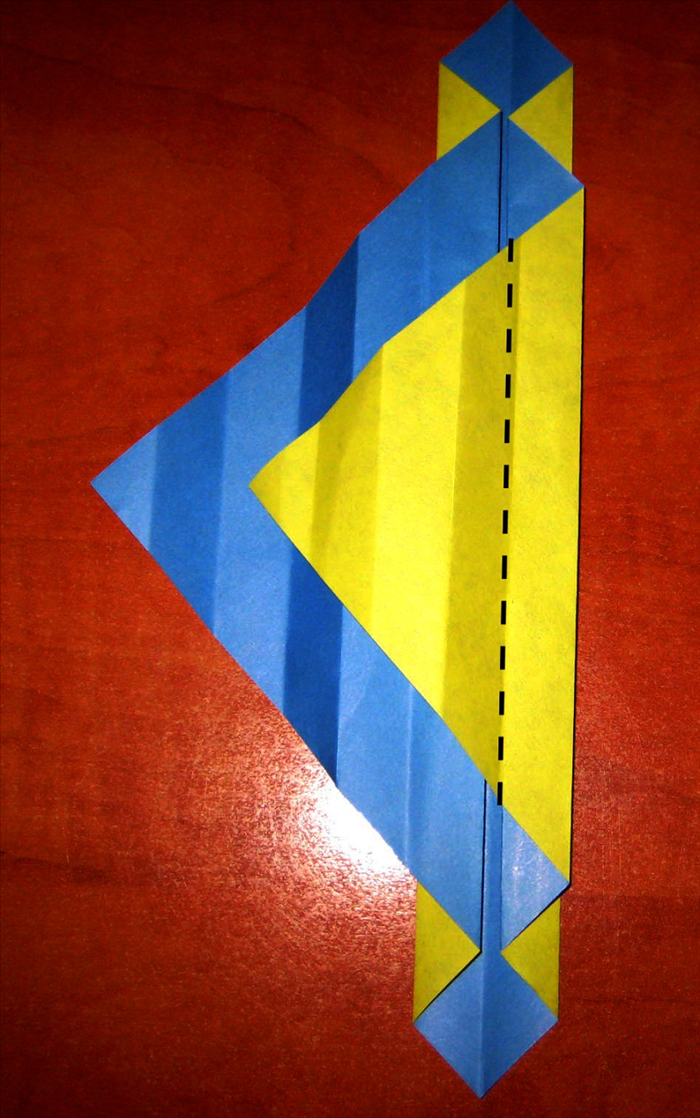 Fold it back again to the right along the crease that aligns with the center.