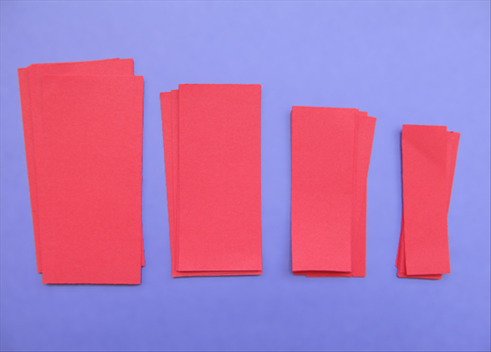 Cut 6 rectangles of each size: 2 inches X 4 inches 1 ¾ inches X 3 ¾  inches 1 ½  inches X 3 ½ inches 1 ¼ inches X 3  ¼ inches