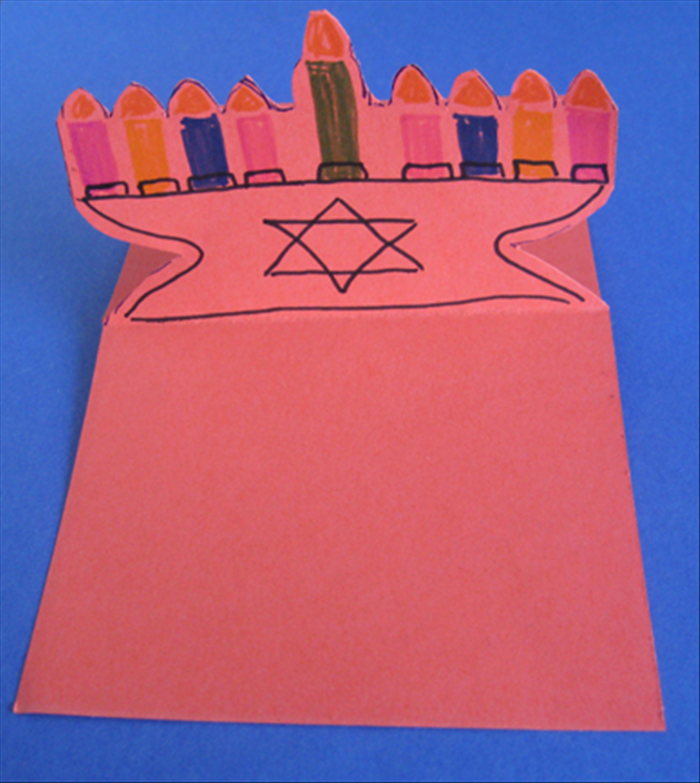 Decorate both the front and the back of the menorah with colored markers or glue colored papers