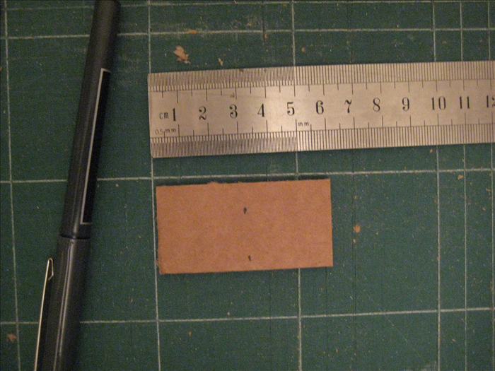 Place the  rectangles with the short ends at the sides. Measure and mark the middle as shown in picture.