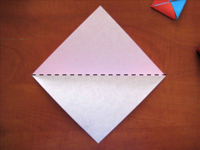 If using paper of 2 colors place the colored   side you want for the outside petal facing down