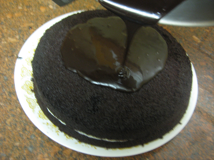 Pour the icing right away on top of the cake