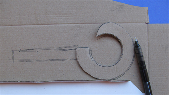 Place the cut circle on cardboard.  Trace the outline of the cut circle and add straight lines about 2 ½ inches long. See the picture.  Cut out along all the lines you just made