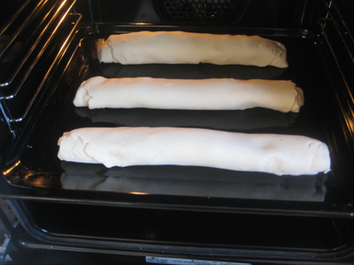 Roll up the dough and squeeze the side ends closed.  