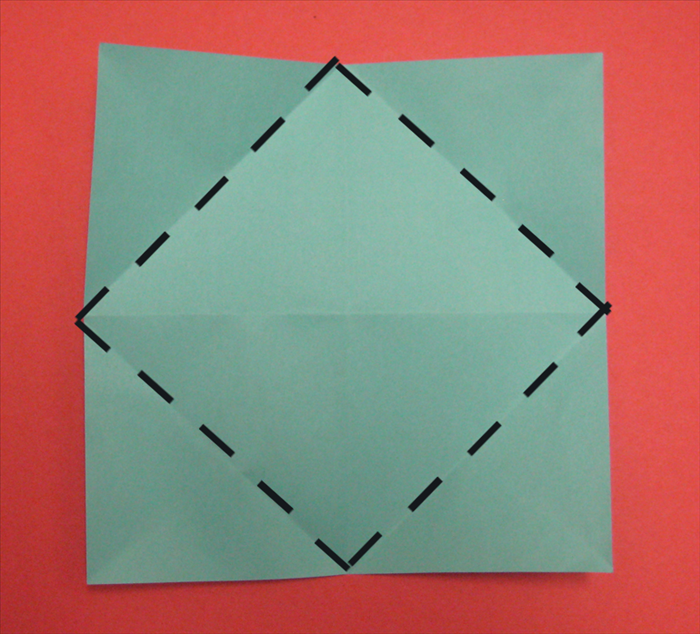 Fold the corner points to the center.