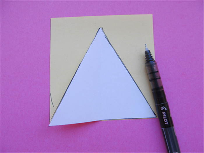 <p> Trace the triangle on the second square paper</p>
