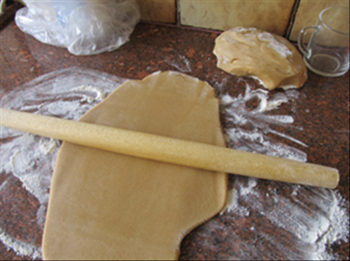Roll out the dough to about ¼ inch thick with a floured rolling pin on a flour surface