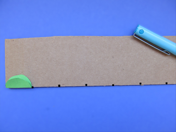 <p> You will need 12 squares of cardboard.</p>  <p> Use the folded edge of the circle to mark the width of the squares.</p>  <p> Cut the cardboard at the marks</p>  <p>  </p>