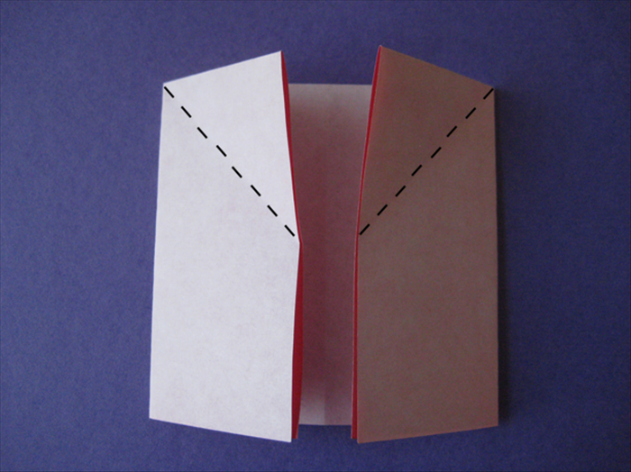 Fold the left inside point down to the left and align the edge.