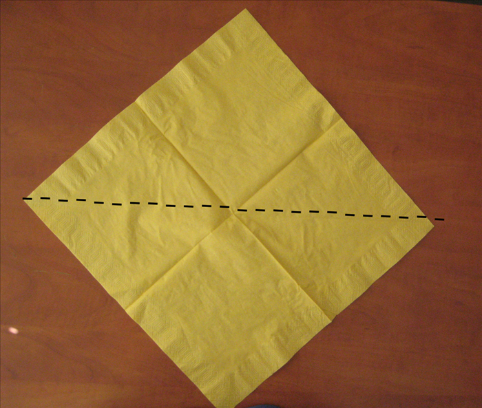 Open the napkin completely. 