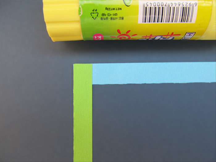 Glue the vertical strip on top of the left edge of the horizontal strip.