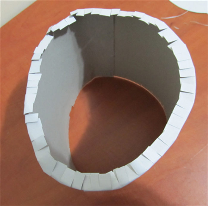 Fold the slit edge inward