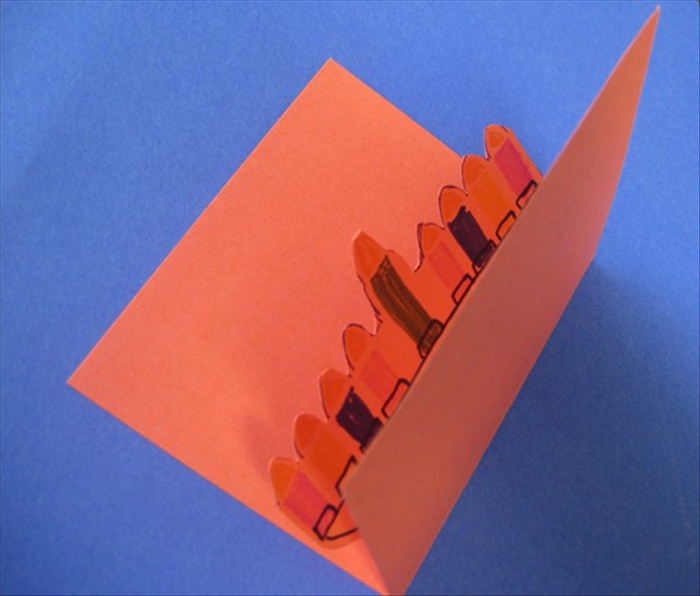 Fold both sides up at the crease at the bottom of the menorah Press to crease it well when closed