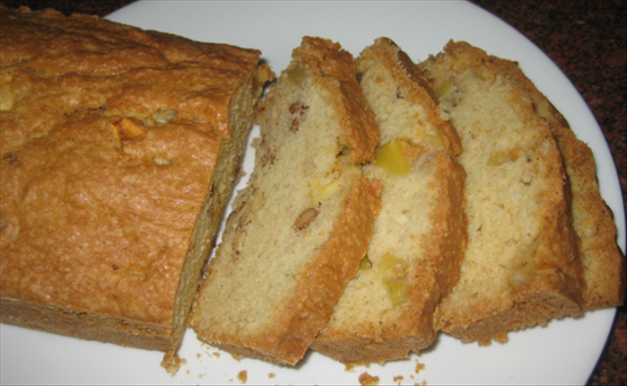 Let the apple bread cool before removing it from the baking pan.
