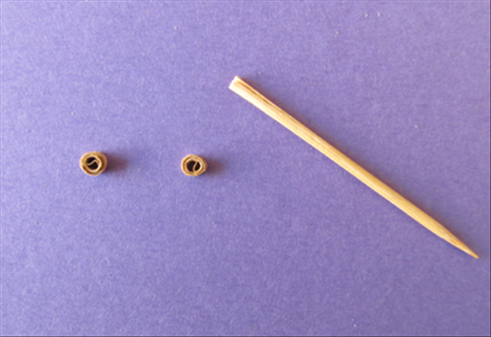 Roll them tightly on the toothpick and glue the ends.