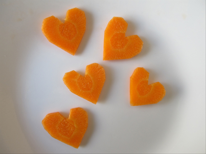 Your heart shaped carrot slices are ready to decorate your food. Bon Appetite!