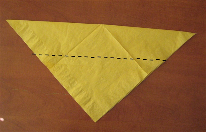 Fold the bottom tip up so that it slightly overlaps the top edge.