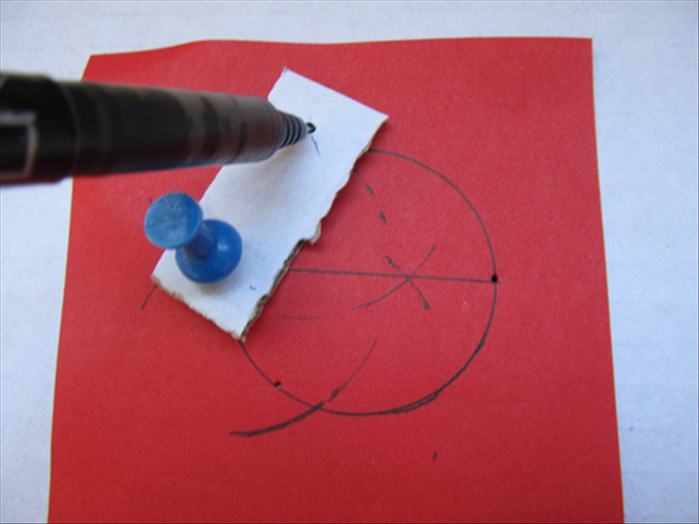 Push a pin through a hole in the cardboard strip and through one of the holes you just make. Insert the pencil in the other hole, swivel the cardboard strip and mark the arc at the top and bottom.
