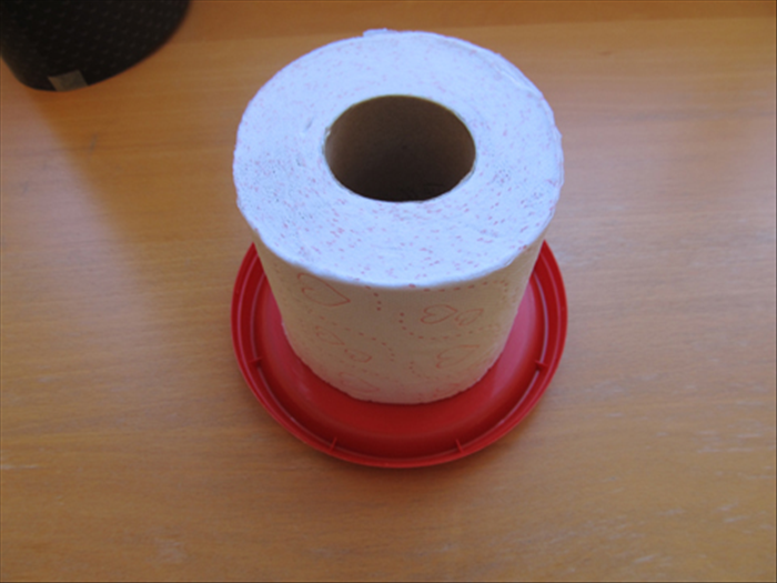Check to see if one of the round plastic lids is slightly larger than the toilet paper roll.