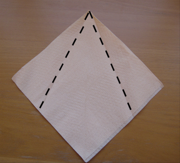 Use a paper napkin  as it comes folded in the  