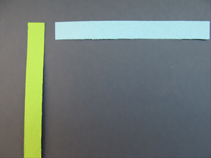 Place one paper strip horizontally and another vertically