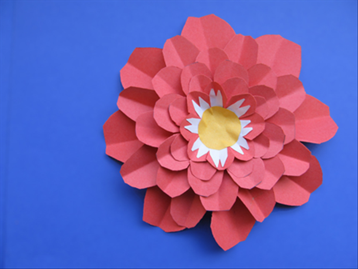 Repeat step 16 until you have glued all the petal layers. Your flower decoration is ready!