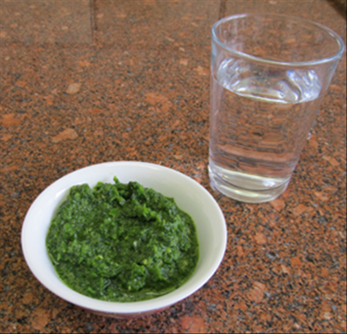 Ingredients:  1 large bunch cleaned coriander 8 -10 hot green peppers with the stems cut off 6 cloves of garlic crushed ½ teaspoon cumin powder ½ teaspoon salt 2 tablespoons oil