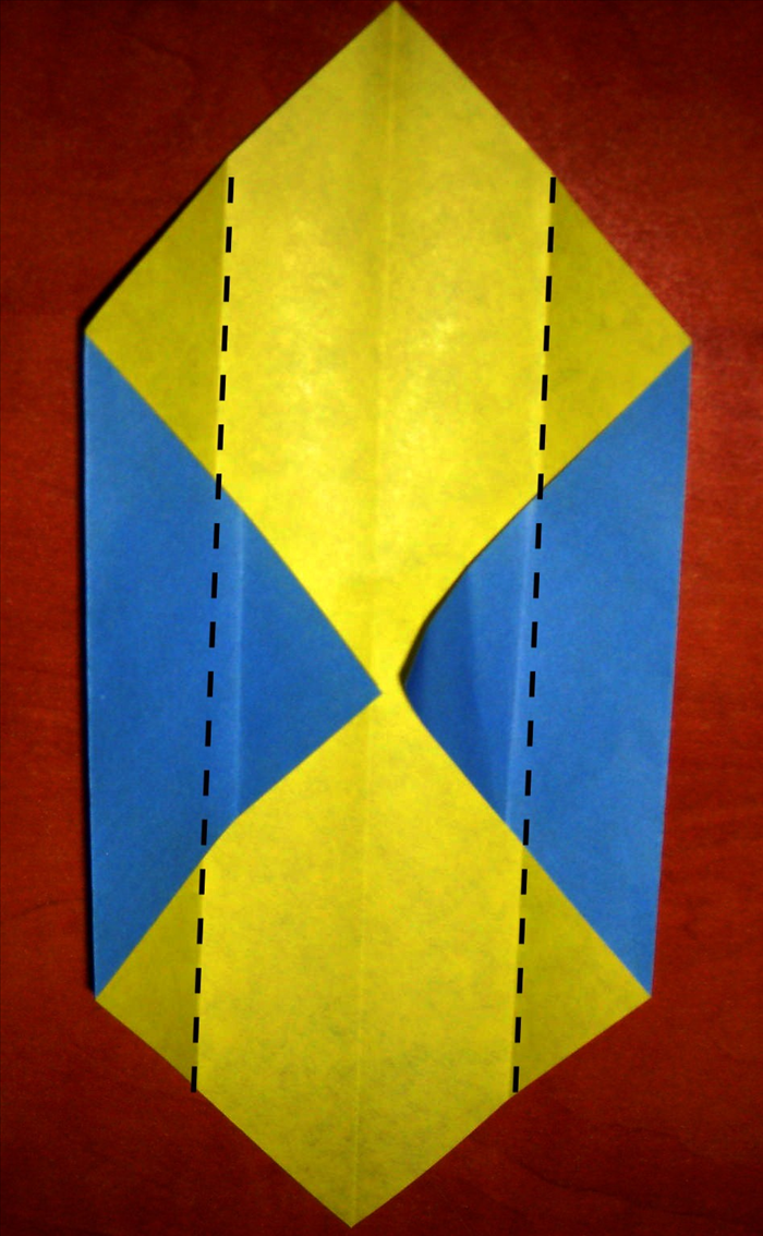 Fold the 2 sides to align with the center crease.