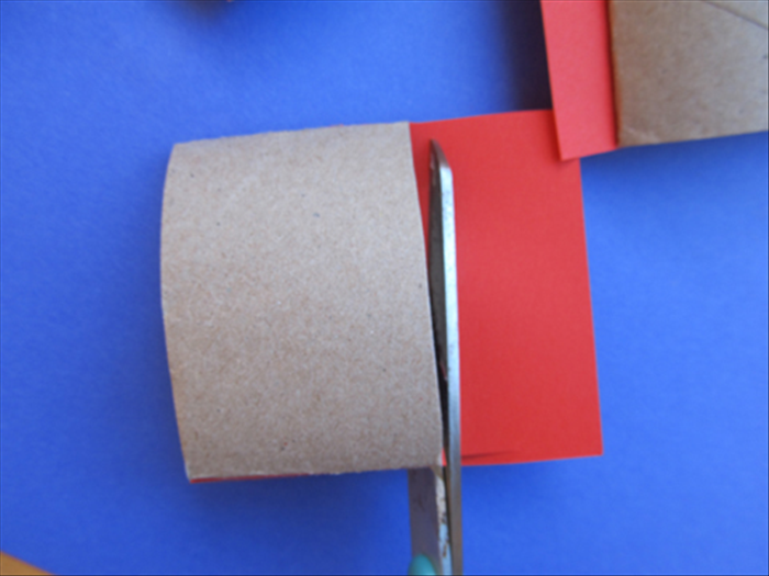 Cut off the extra paper sticking out around the roll.