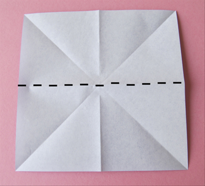 Flip the paper over to the back side  Fold it in half horizontally and unfold Fold it in half vertically and unfold