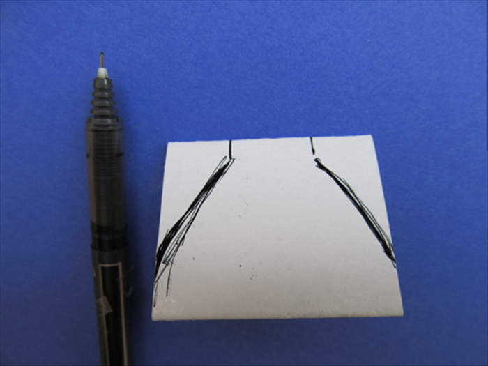 Make the marks at the top ¼ inch long.  Draw a slight curve from the bottom of the marks to the bottom points See the picture