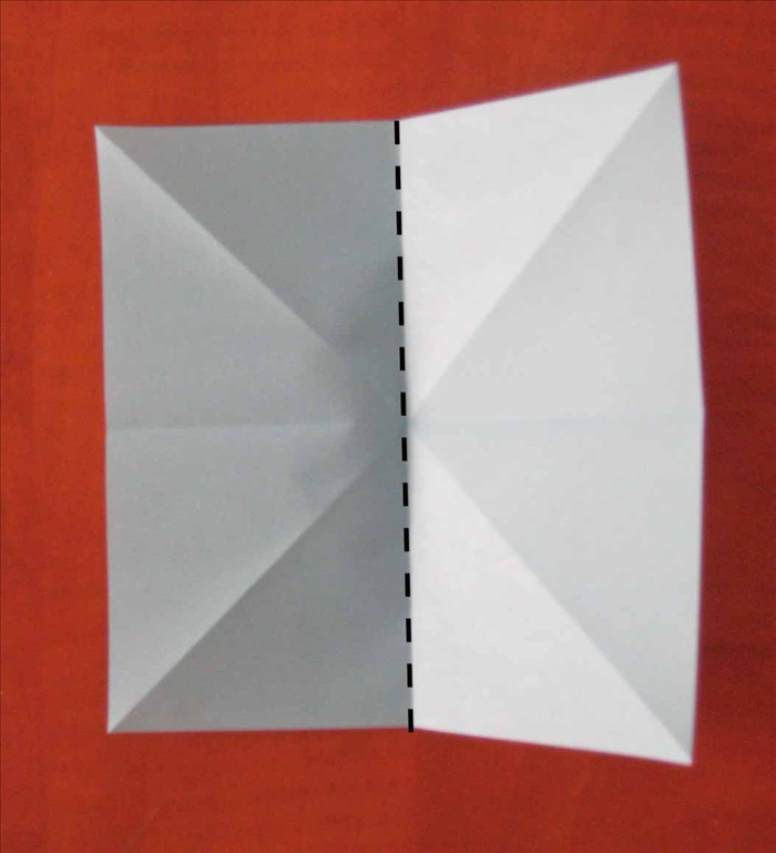 Fold the paper in half vertically and unfold