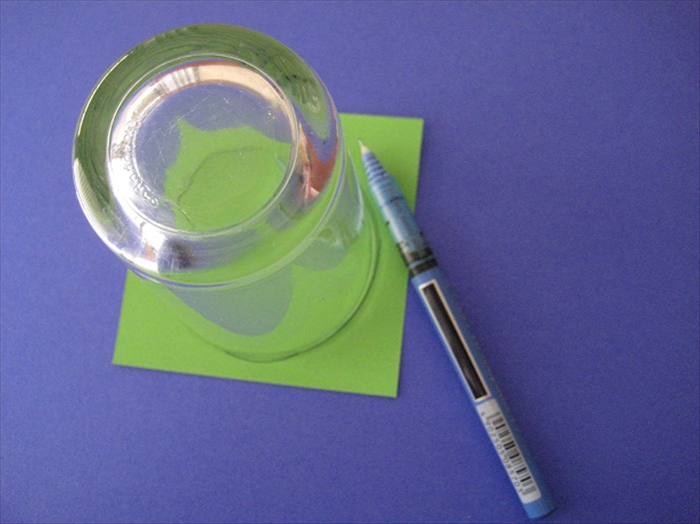 Trace a circle around a small to medium sized object. Cut it out and glue it to the center.