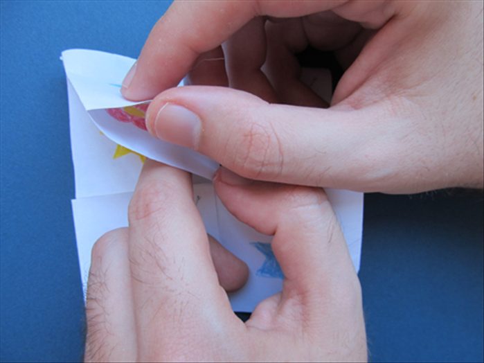 Push your finger inside to help the fold go inward